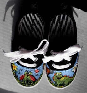 Painted child's sneakers