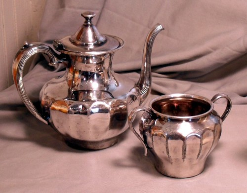 A flea market find, this silver teapot and sugar bowl cost less than $10.