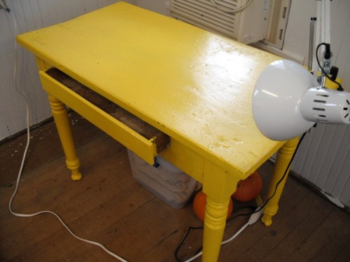 Small table for still lifes.  I meant to refinish this but the yellow has grown on me.