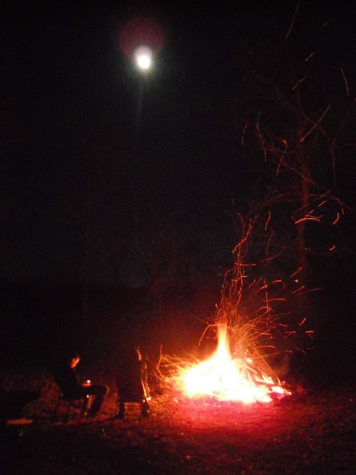 Campfire with the full moon overhead.