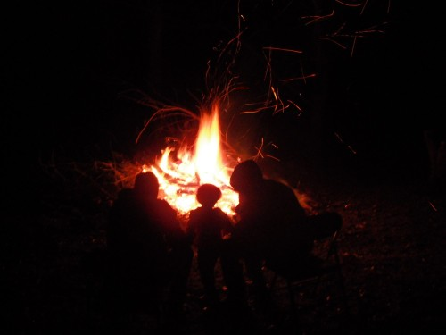 How long have humans been gathering around a campfire?
